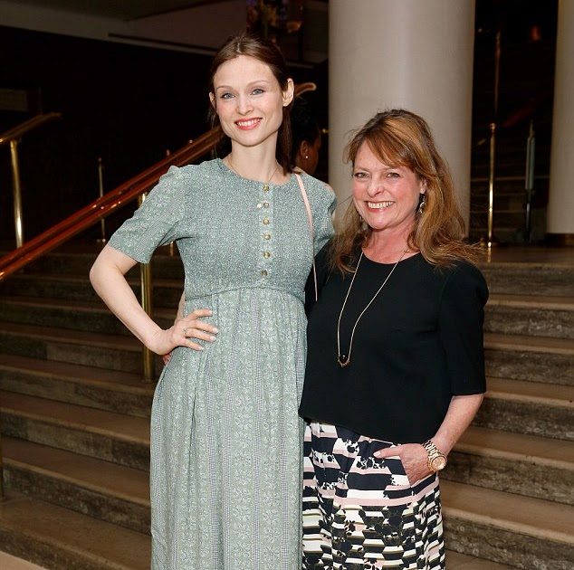 0afa3560e60 Sophie Ellis-Bextor shows off her baby bump in pretty print dress as she  enjoys a night out with youthful looking mum Janet Ellis