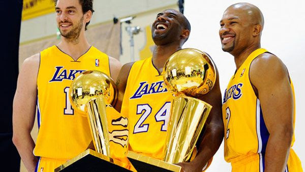 Pau Gasol, Kobe Bryant and Derek Fisher pose for a group photo at the Los Angeles Lakers' Media Day event in El Segundo California...on September 25, 2010.