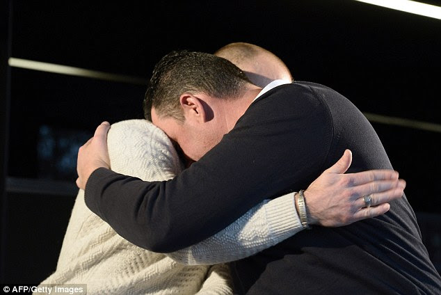 Embrace: The pair hugged as they spoke to the media in an emotionally-charged press conference