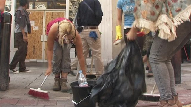 Clear up begins in Clapham after riot