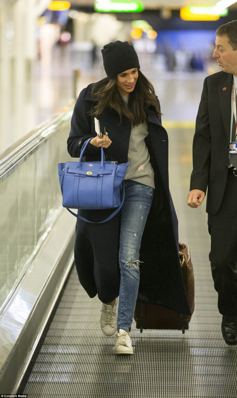 Meghan Markle was spotted at Heathrow airport before boarding a flight back to Canada as she and Harry go their separate ways for Christmas