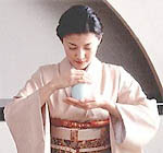 Woman smelling incense
