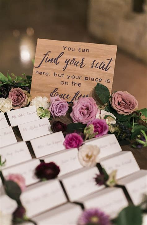 Decorating your escort card table with fresh flowers is a
