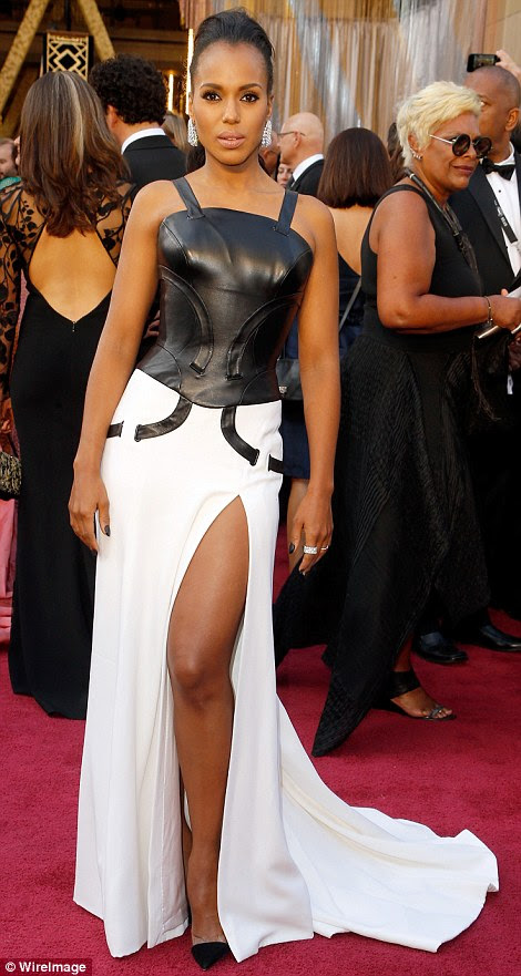 Daring: Kerry Washington took a risk in a black and white Atelier Versace gown with a leather top and slit skirt