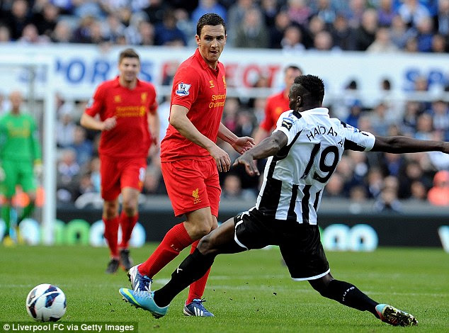 No avial: Massadio Haidara flies in to try and win the ball from Liverpool's Stuart Downing