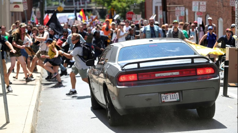 A vehicle drives into a group of people demonstrating against a white nationalist rally after police cleared Emancipation Park on Saturday, August 12, in Charlottesville, Virginia.