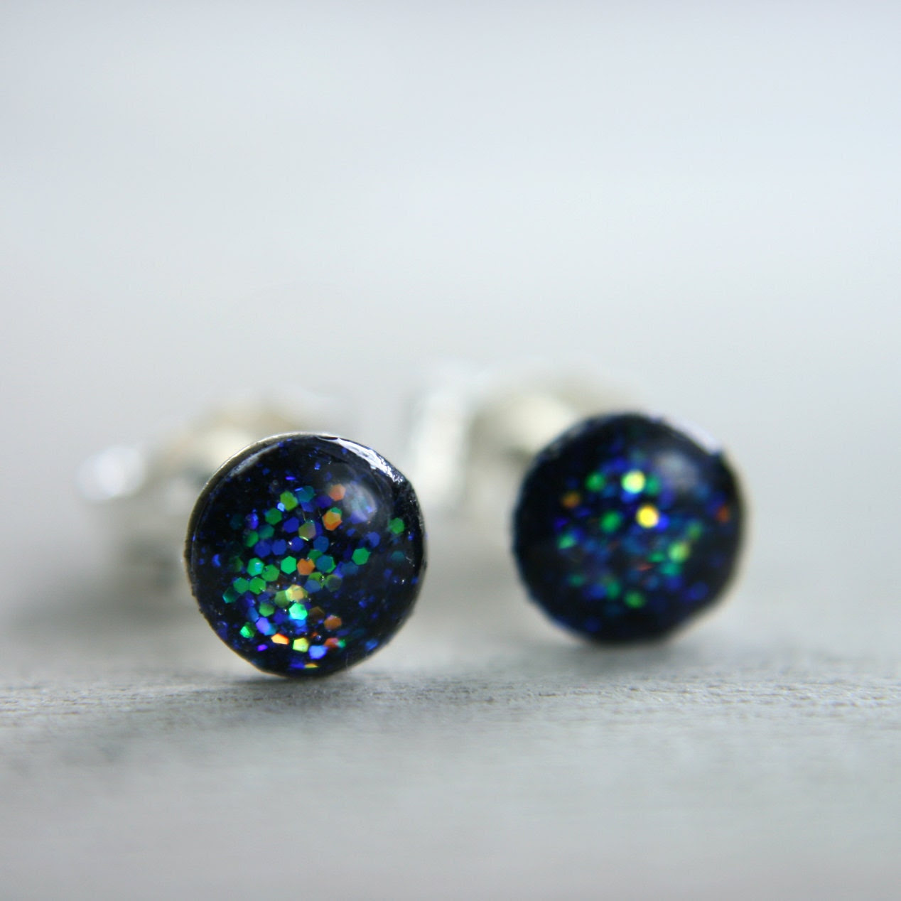super tiny circle post earrings in sparkly deep blue galaxy