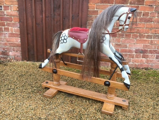Restored antique rocking horse by Lines.