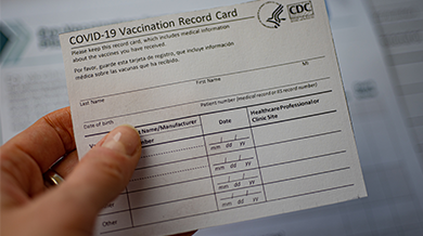 Person holding a CDC vaccination card