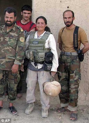 Battle lines: Associated Press photographer Julie Jacobson, (centre) standing with unidentified members of the Afghan National Army.