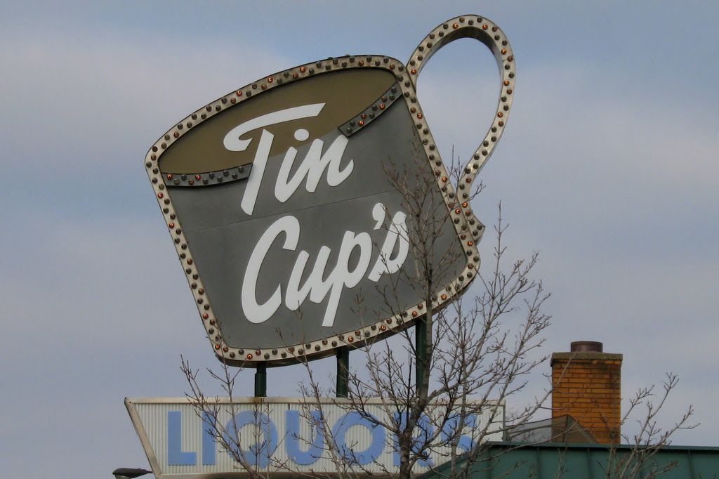 a business sign on Rice Street in St Paul reads Tin Cups.