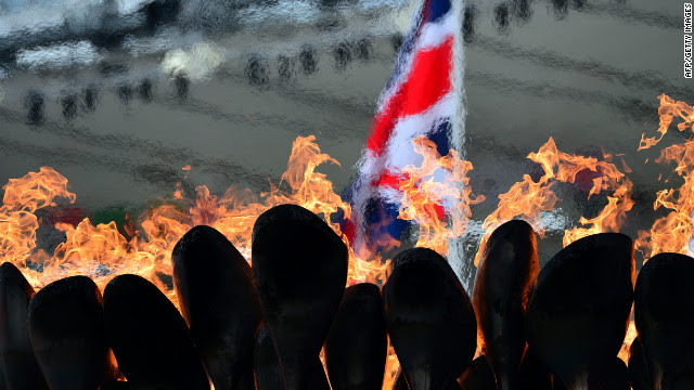 The Olympic flame burns in the cauldron at Olympic Stadium on Tuesday, the fourth day of the Games.