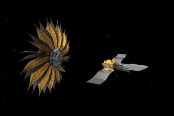 An artist's illustration of the Starshade deployed near its companion telescope. Image: NASA