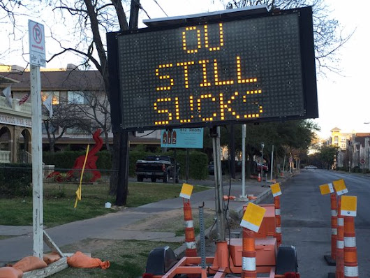 "Someone Hacked A Traffic Sign on 24th & Rio Grande To Say ""OU Still Sucks"""