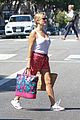 reese witherspoon pairs her white tank with a skirt shorts 01