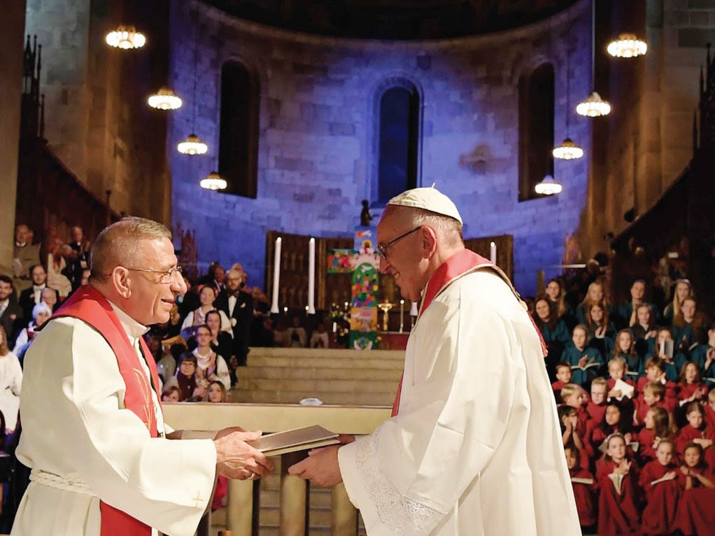Papa Francisco com o presidente da Federação Luterana Mundial
