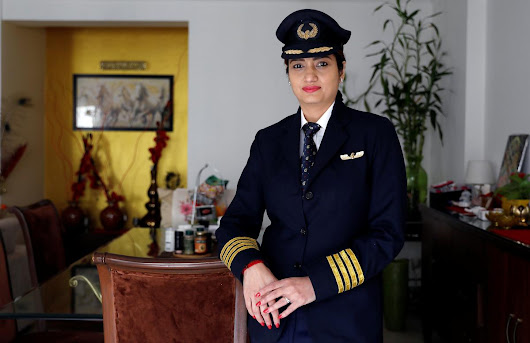 India soars above global average in hiring female airline pilots | Reuters
