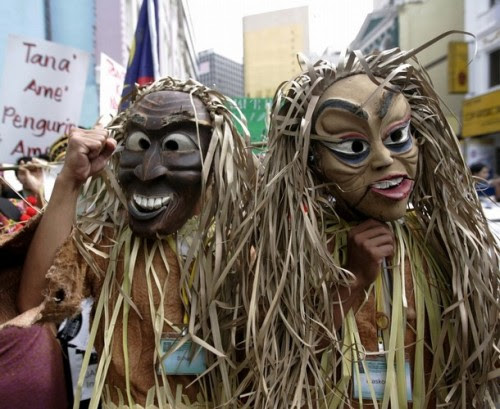 Malaysia's indigenous people wear masks as they gather during a demonstration to call for the government to implement the individual and collective rights of indigenous people, in Kuala Lumpur September 13, 2008.
