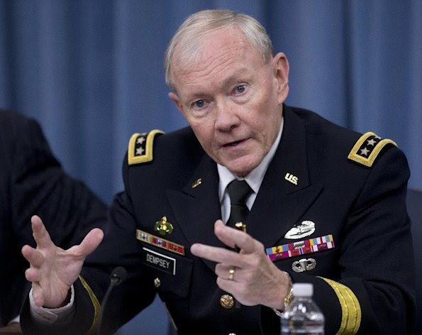 FILE – In this May 17, 2013 file photo Chairman of the Joint Chiefs of Staff, Gen. Martin Dempsey, speaks during a Pentagon news conference about sexual assaults in the military, among other topics. Dempsey and the four-star chiefs of the services are scheduled to testify Tuesday, June 4, 2013, at a high-stakes Senate hearing on congressional proposals to modify the military justice system to stem the flow of the escalating number of sexual assaults that have outraged Republicans and Democrats on Capitol Hill. (AP Photo/Carolyn Kaster, File)