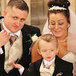 Terminally ill boy, 2, moves congregation to tears as he delivers mother and father's wedding rings in his favourite toy car