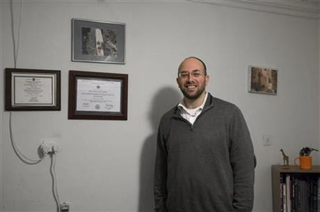 Dr. Elan Karten poses for a portrait at his office in