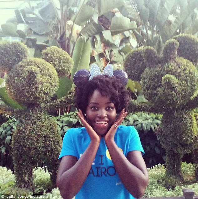 'First trip to #Disneyland!!!': She shared a picture as she made her arrival at the amusement park, posing in front of some hedges trimmed to look like Mickey and Minnie Mouse
