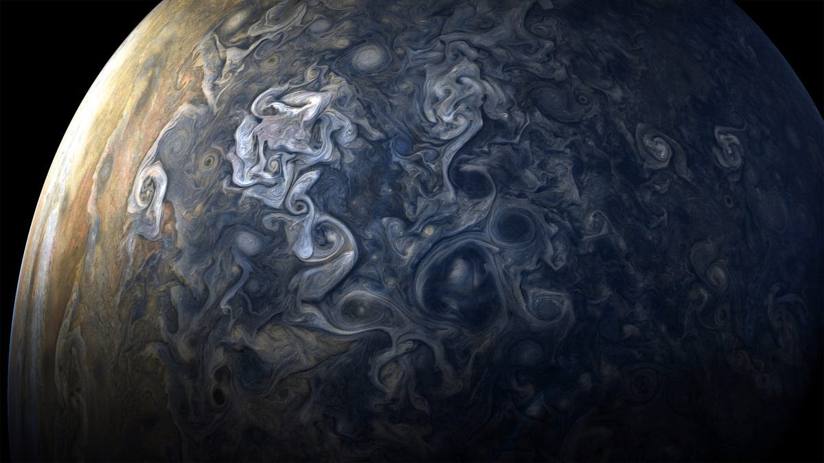 Then Juno flew back out into deep space, passing over Jupiter's south pole on its exit. Churning storms at the poles constantly change their appearance.