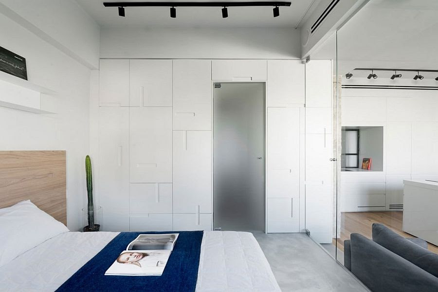Custom cabinets in the bedroom give it a chic, contemporary look