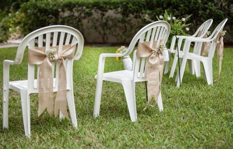 dressed white plastic chairs with burlap detail.   DYI low