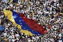 Protesters mass in Venezuela, for and against Maduro