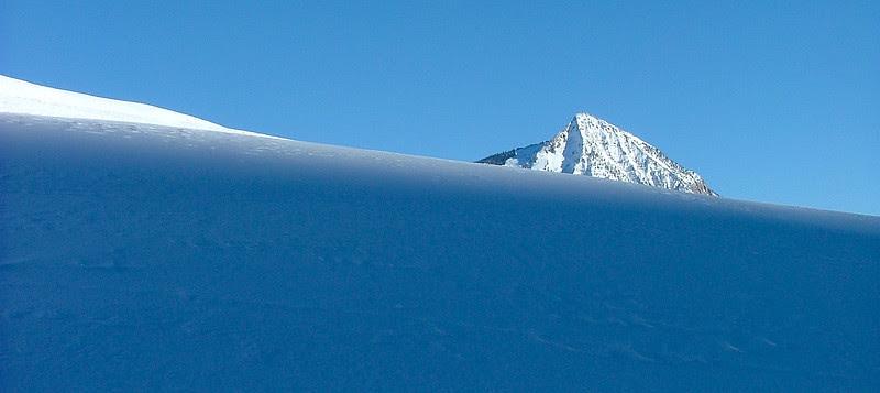 Mount Crested Butte is peeking over the ridge at sundown.