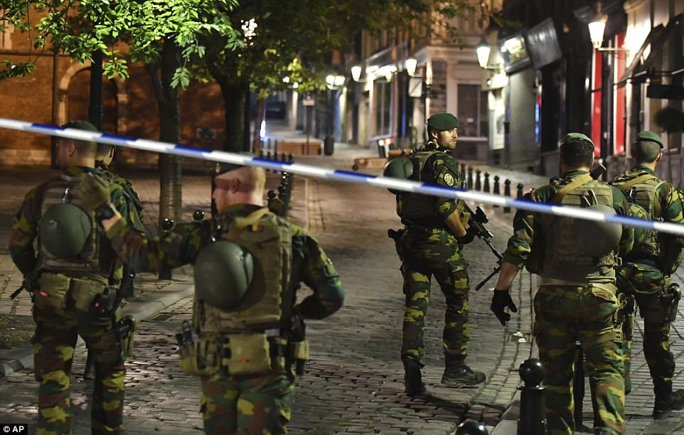 Belgian Army soldiers patrol outside Central Station after the explosion in the busy station in the Belgian capital