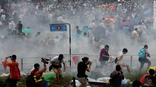 Police, protesters clash as Hong Kong demonstrations turn violent
