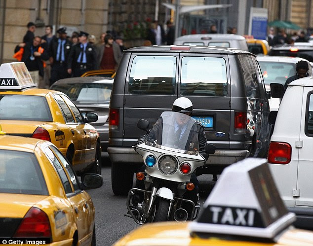 Coming through: An actor playing an American traffic cop weaves his way through the taxis