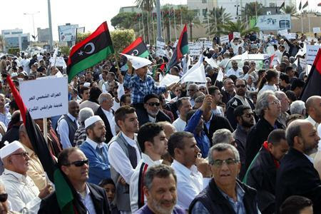 Protesters march during a demonstration calling on militiamen to leave, in Tripoli November 15, 2013. REUTERS-Ismail Zitouny (
