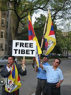 Tibetans wait for President Hu of China. Tibet...