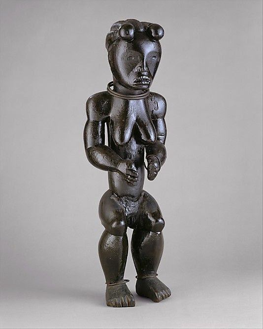 Figure from a Reliquary Ensemble: Seated Female  Date: 19th–early 20th century Geography: Gabon or Equatorial Guinea Culture: Fang peoples, Okak group Medium: Wood, metal