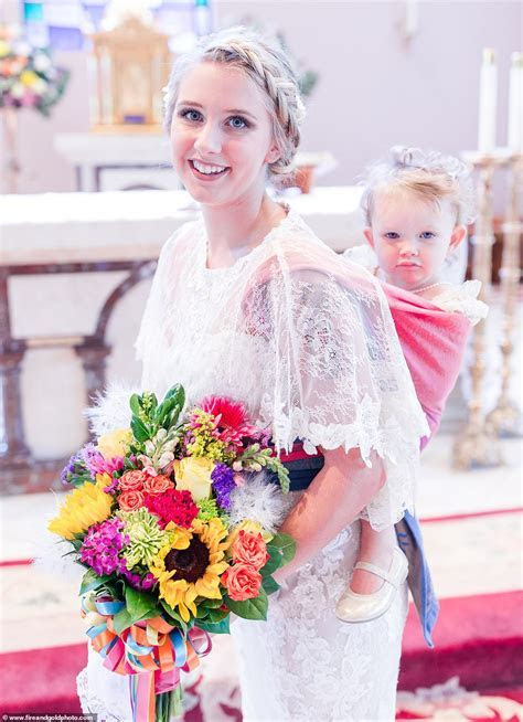 Stunning wedding photos see bride carrying her daughter