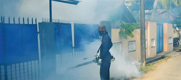 A health worker fumigating an area in Batticaloa.
