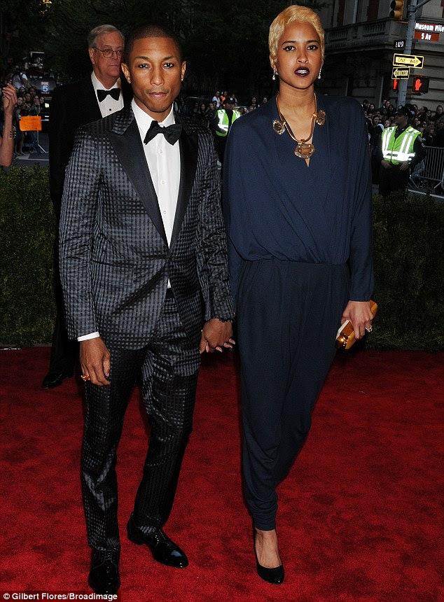 Cute couple: Pharrell Williams attended alongside his fiancee, model and designer Helen Lasichanh