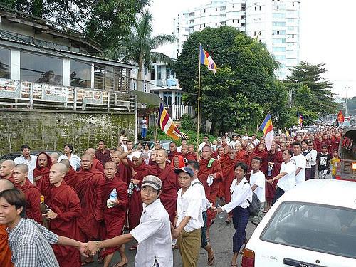 human chain around the monks