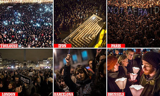 Crowds gather in Paris in solidarity with murdered journalists