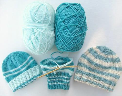 three baby hats