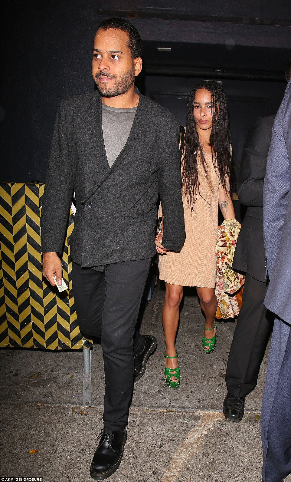 Handsome pair: The actress was joined by her boyfriend, musician Twin Shadow, who led her by the hand as they left the event
