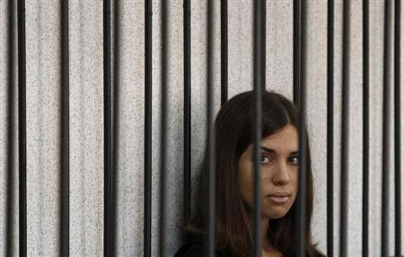 Member of the female punk band ''Pussy Riot'' Nadezhda Tolokonnikova looks out from a holding cell as she attends a court hearing to appeal for parole at the Supreme Court of Mordovia in Saransk, July 26, 2013. REUTERS/Sergei Karpukhin