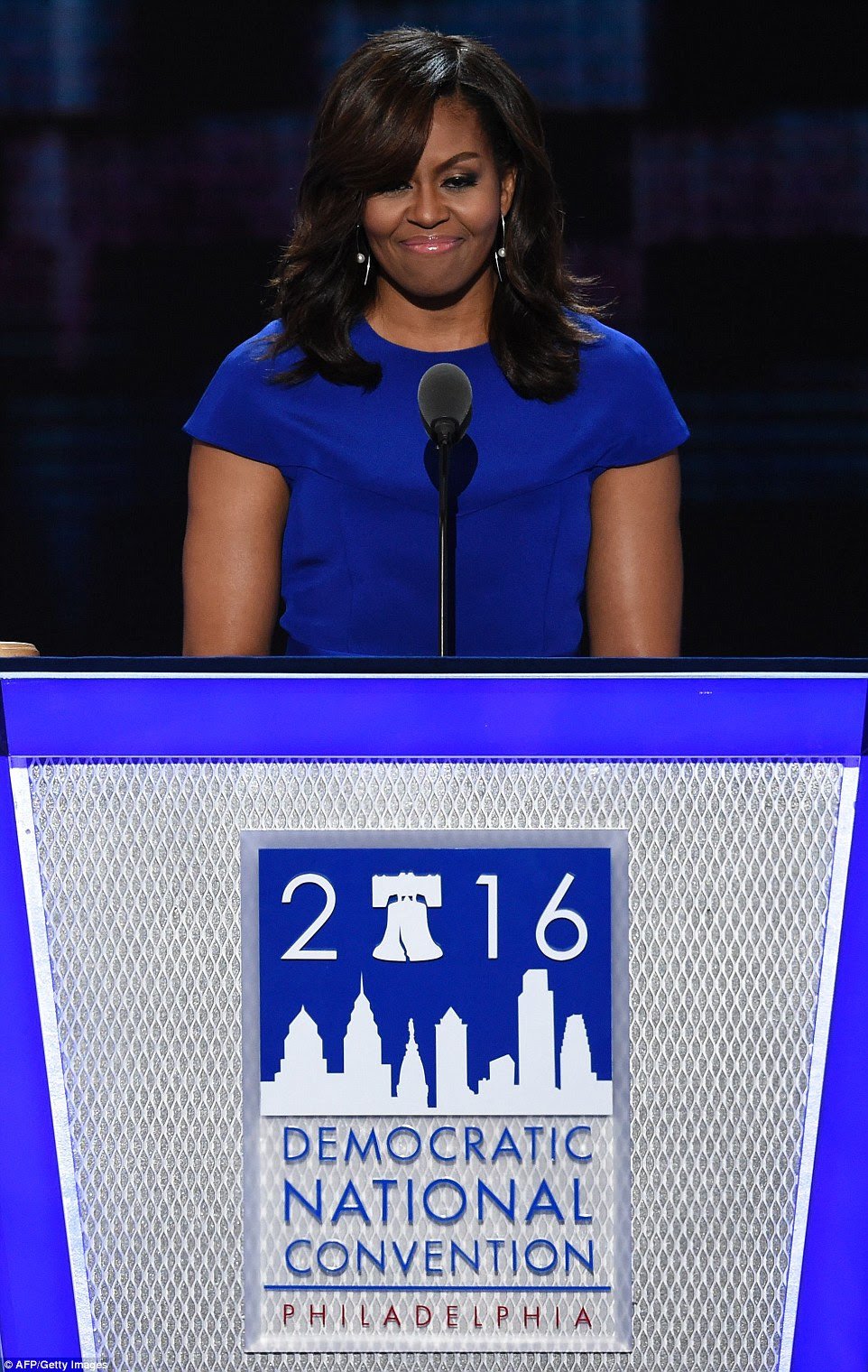 First lady Michelle Obama's convention speech Monday night began as a pleasant story about her teenage daughters who arrived at the White House as children