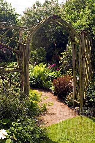 Gardenbeamflower rustic wooden arch and trellis work at for Garden archway designs