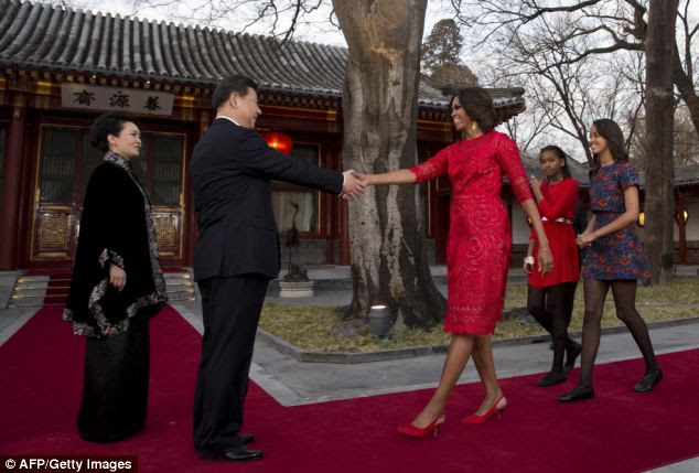 'Mrs. Diplomat': Chinese President Xi Jinping joined in Friday for events that were supposed to include just Mrs. Obama and Chinese first lady Peng Liyuan. The White House has insisted that the trip is a cultural exchange and not a political mission, however.