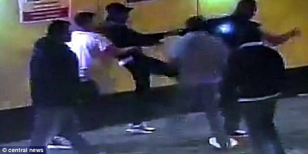 Terrifying:CCTV footage shows Mr Hounye being kicked mercilessly