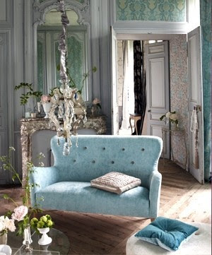 Aqua blue sofa completes this room...